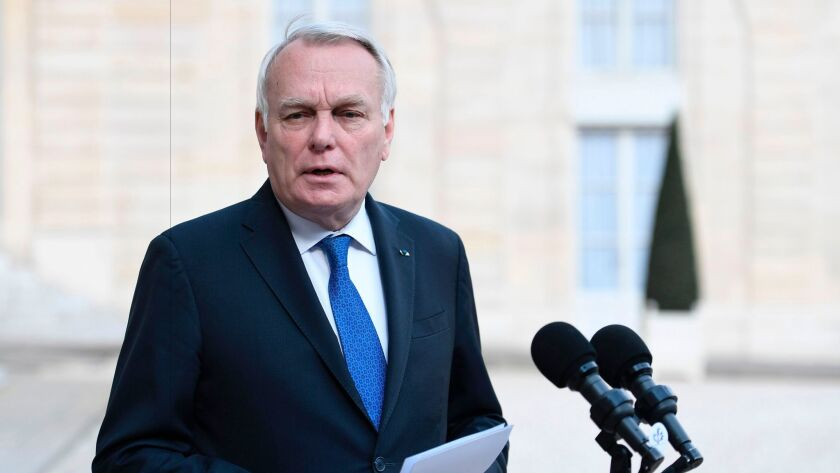 French Foreign Minister Jean-Marc Ayrault speaks to reporters on April 26, 2017, at Elysee Palace in Paris.