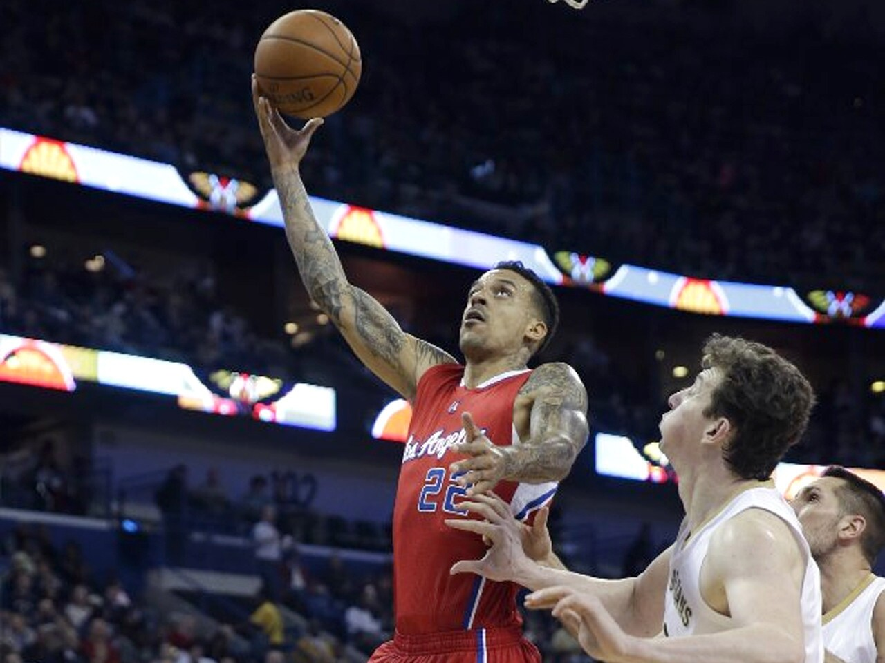 Clippers forward Matt Barnes shoots a layup in front of Pelicans center Omer Asik in the first half.