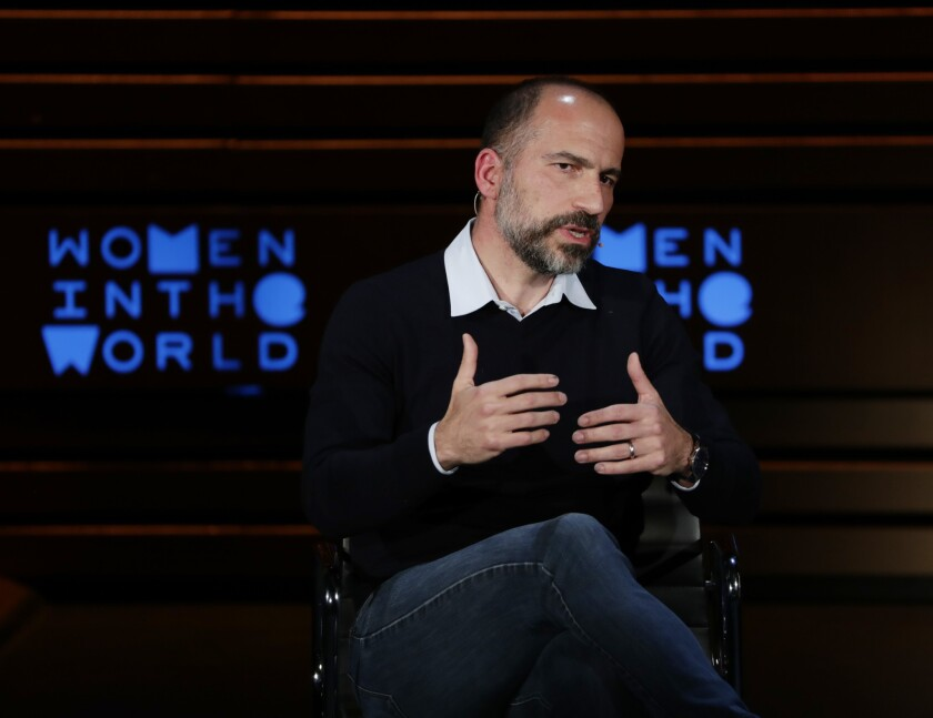 Uber CEO Dara Khosrowshahi gestures while he speaks seated onstage at the Women in the World summit
