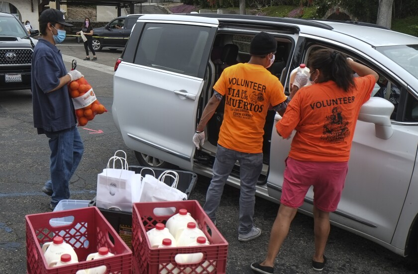 Volunteers distributing food on Saturday, May 2.