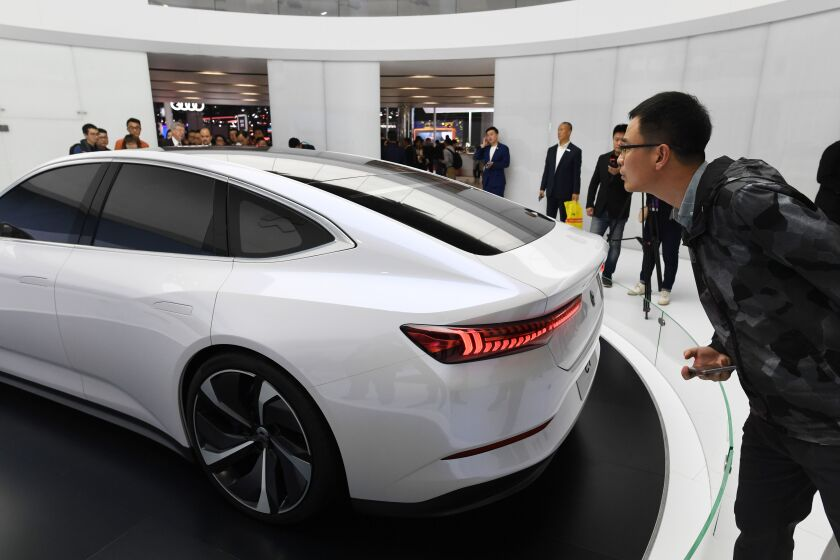 A visitor looks at a NIO ET Preview car on the opening day of the Shanghai Auto Show in April.