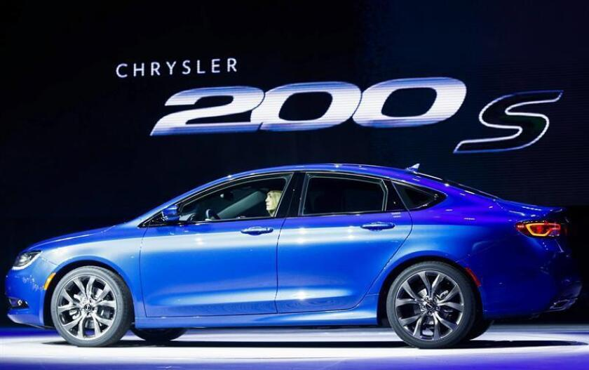 The new 'Chrysler 200 S' is driven onto the stage as it is introduced at the North American International Auto Show at the Cobo Center in Detroit, Michigan, USA, on 13 January 2014. EFE/EPA/File