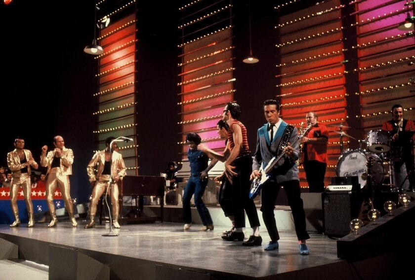 """The Godfather of Soul, James Brown, performed 'Too Funky in Here' on the Sha Na Na show. During the taping, Brown gave props to Sha Na Na drummer Jocko Marcellino for his rhythm. """"He put out his hand and he wanted to give me five on the track,"""" Marcellino recalled. """"To get that kind of kudos from t"""