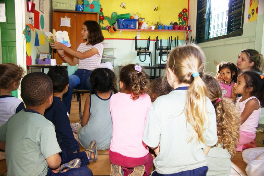 Beatriz De Oliveira, 17, of Carmel Valley, reads to a group of preschool students in her native Brazil. She runs Books for a Change, an organization that provides free books to underfunded preschools in Brazil.