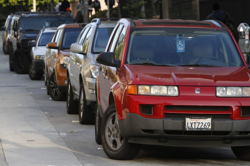 A line of cars displaying disabled placards are parked near 4th and Hill in downtown Los Angeles on Feb. 10, 2012.