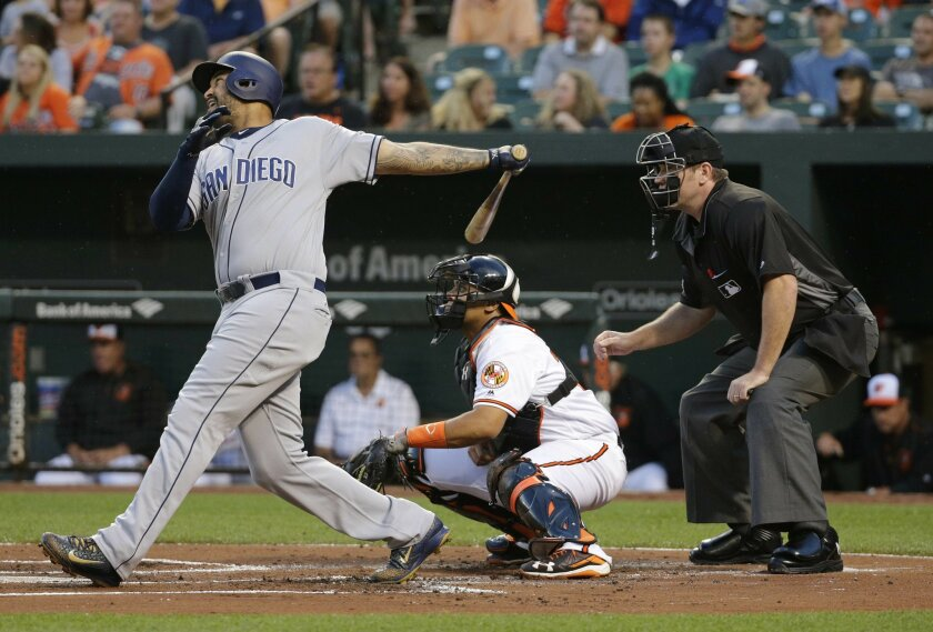 San Diego Padres' Matt Kemp, left, singles in front of Baltimore Orioles catcher Francisco Pena and home plate umpire Chris Conroy in the first inning of an interleague baseball game in Baltimore, Tuesday, June 21, 2016. Travis Jankowski scored on the play. (AP Photo/Patrick Semansky)