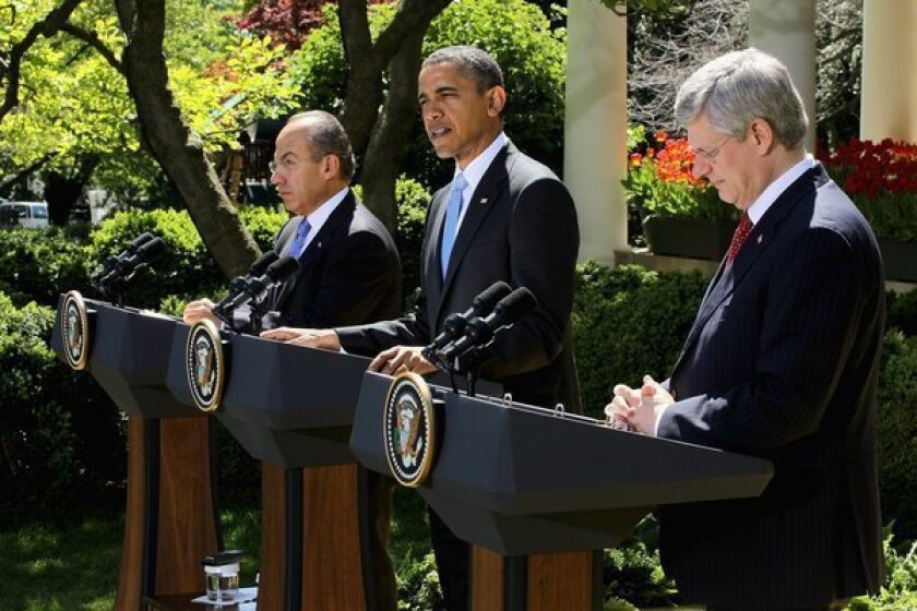 President Obama speaks as Canadian Prime Minister Stephen Harper and Mexican President Felipe Calderon participate in a joint press conference in the Rose Garden of the White House on Monday.