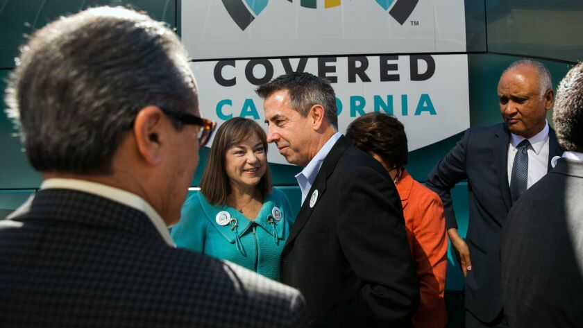 Covered California Executive Director Peter V. Lee, center, mingled with federal lawmakers and others during the launch of open enrollment for Obamacare health plans in 2015.