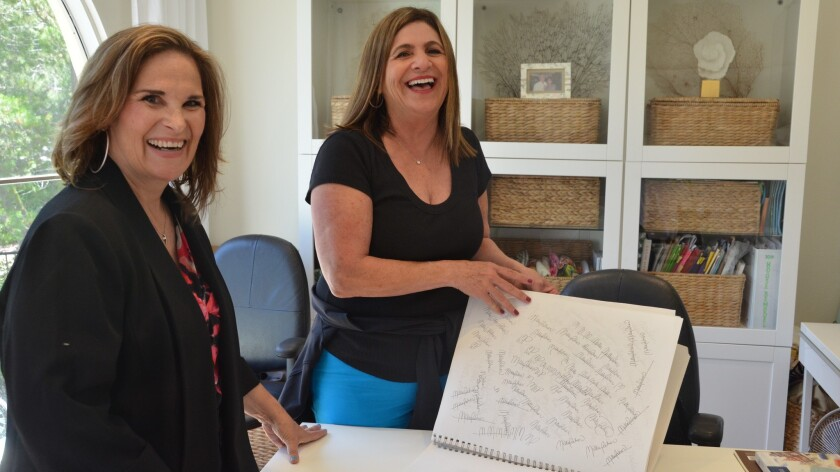 Art instructor, Sonserae Leese, left with her student, Millie Palmer share a laugh during a private