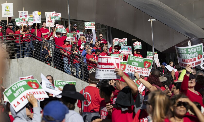 LOS ANGELES, CA - DECEMBER 15, 2018: Hundreds of protesters line the stairs at Disney Hall to join