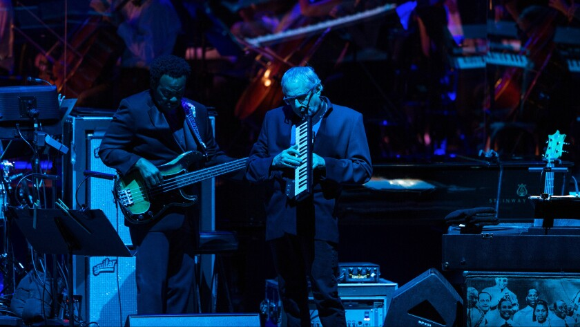 Donald Fagen (center) co-founded Steely Dan in 1972 and is forging ahead without guitarist and band co-founder Walter Becker (not pictured), who died in 2017. Fagen is shown above with bassist Freddie Washington at a Hollywood Bowl concert by Steely Dan.