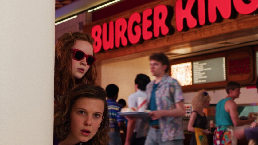 """Sadie Sink, top, as Max and Millie Bobby Brown as Eleven in """"Stranger Things 3."""""""