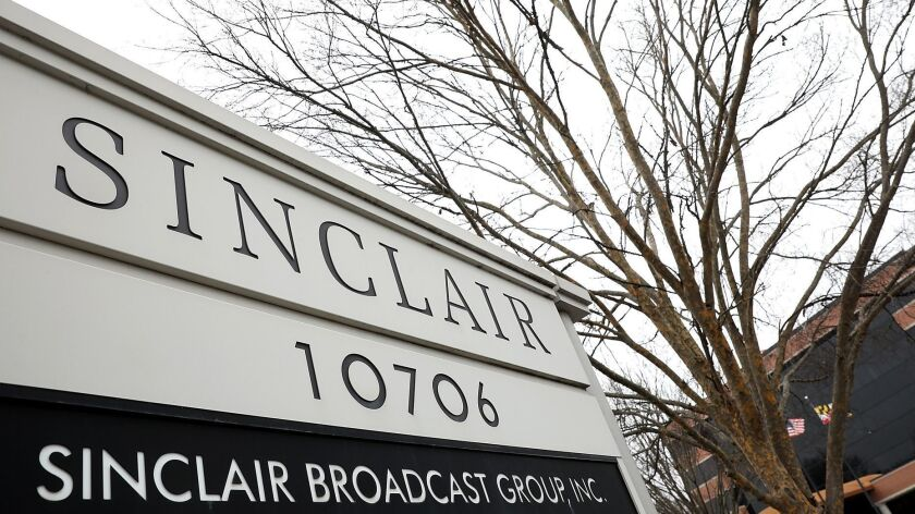 Sinclair agrees to sell 23 TV stations to gain approval for Tribune