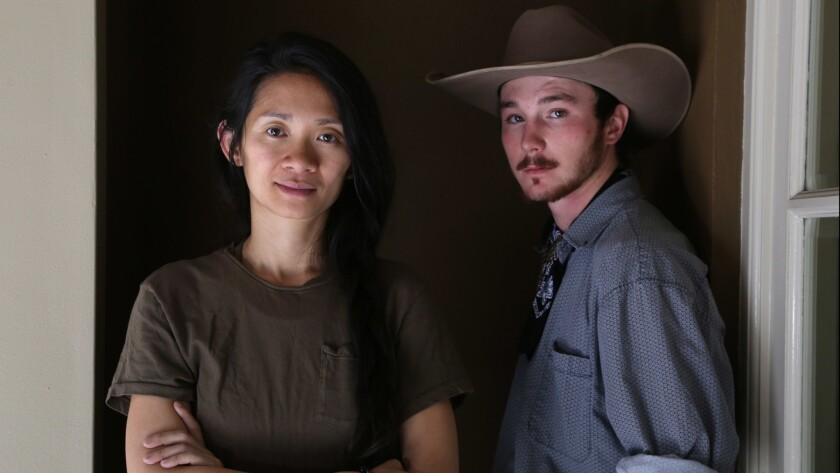 "Director Chloe Zhao, left, and former bronco rider Brady Jandreau of the critically acclaimed indie drama ""The Rider."""