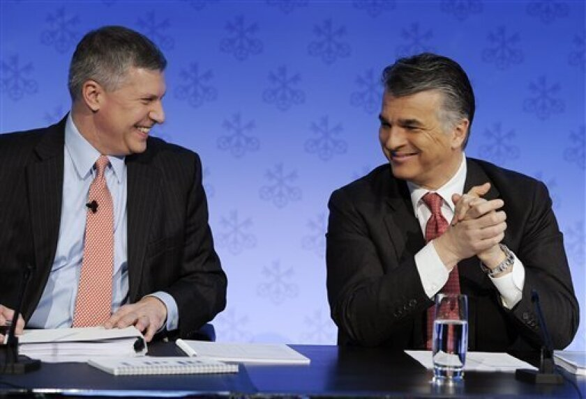 UBS CEO Sergio Ermotti, right, and CFO Tom Naratil, left, prepare to speak at a news conference announcing the bank's 2011 full year result in Zurich, Switzerland, Tuesday, Feb. 7, 2012. Switzerland's biggest bank UBS AG reported Tuesday a 76 percent drop in net profits during the fourth quarter of 2011 compared with the same period in 2010, a sign of continued struggles linked to its $2 billion rogue trading scandal and economic weakness in Europe and abroad. (AP Photo/Keystone, Steffen Schmidt)