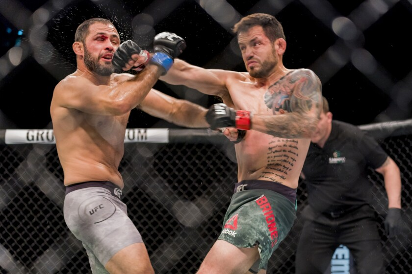 Henry Briones, right, battles Frankie Saenz during a UFC bantamweight fight in Chile in May 2018. Briones was a hockey player before fighting in mixed martial arts.