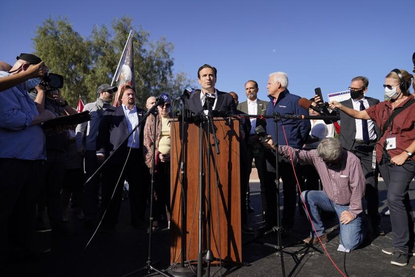 Former Nevada Atty. Gen. Adam Laxalt speaks outside the Clark County Election Department last week.