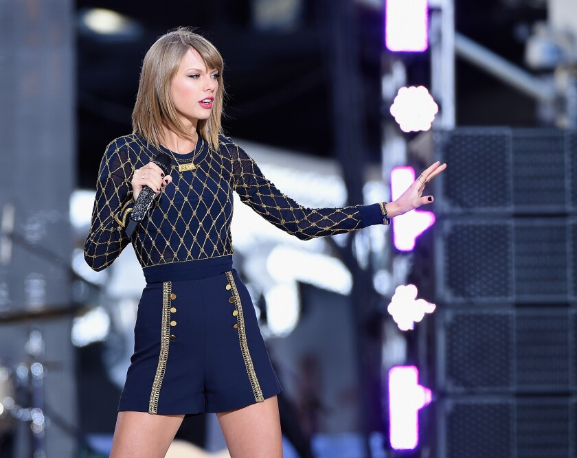 """Taylor Swift, shown performing Thursday in New York on ABC's """"Good Morning America,"""" could be headed for first-week sales of 1.2 million copies of her new """"1989"""" album."""