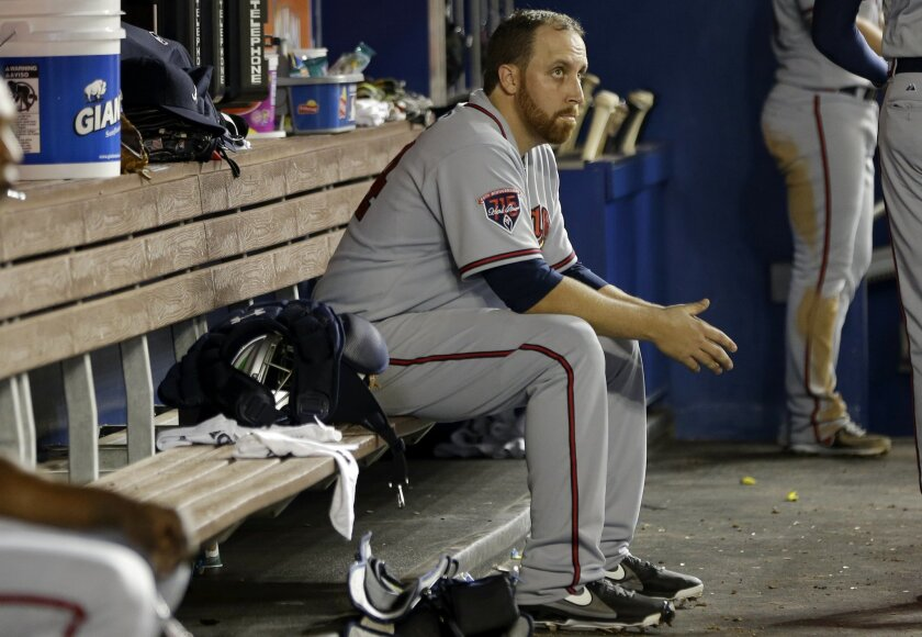 Atlanta Braves starting pitcher Aaron Harang sits in the dugout during the fourth inning of a baseball game against the Miami Marlins, Wednesday, April 30, 2014, in Miami. (AP Photo)