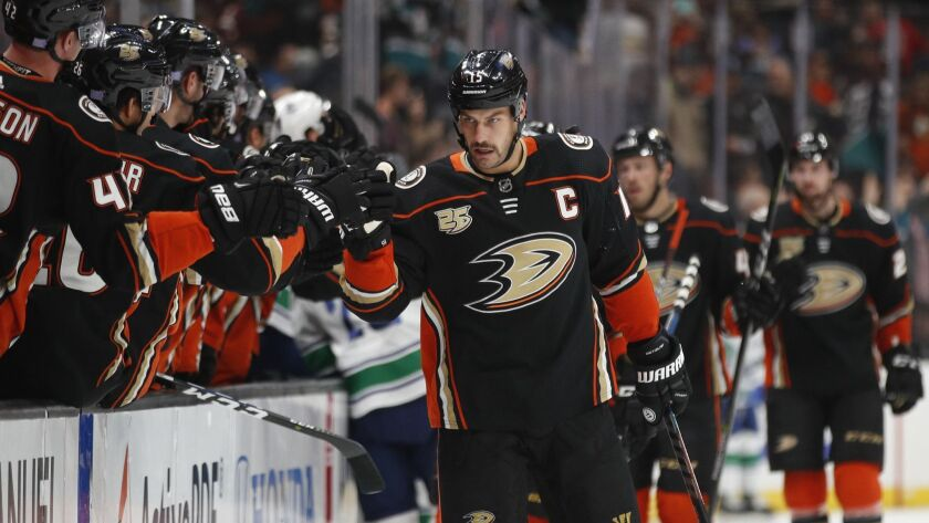 Ducks center Ryan Getzlaf is congratulated by teammates after scoring against the Canucks during the first period Wednesday.
