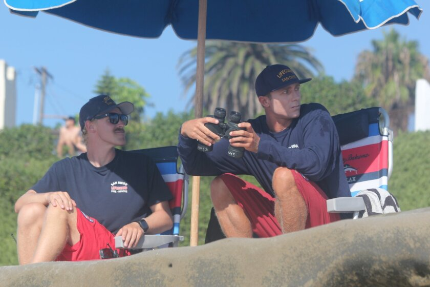 John Maher (right) is San Diego Lifesaving Association's Seasonal Lifeguard of the Year. Here, Maher patrols WindanSea Beach Aug. 30 with fellow lifeguard Luke Collins. Collins assisted in a rescue north of La Jolla Cove July 10 that resulted in UTC's Jacob Petty being chosen for the Citizen Rescue