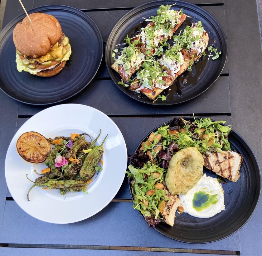 Il team del Kuma Cafe servirà alcuni piatti quest'estate al bar della hall del Guild Hotel nel centro di San Diego.