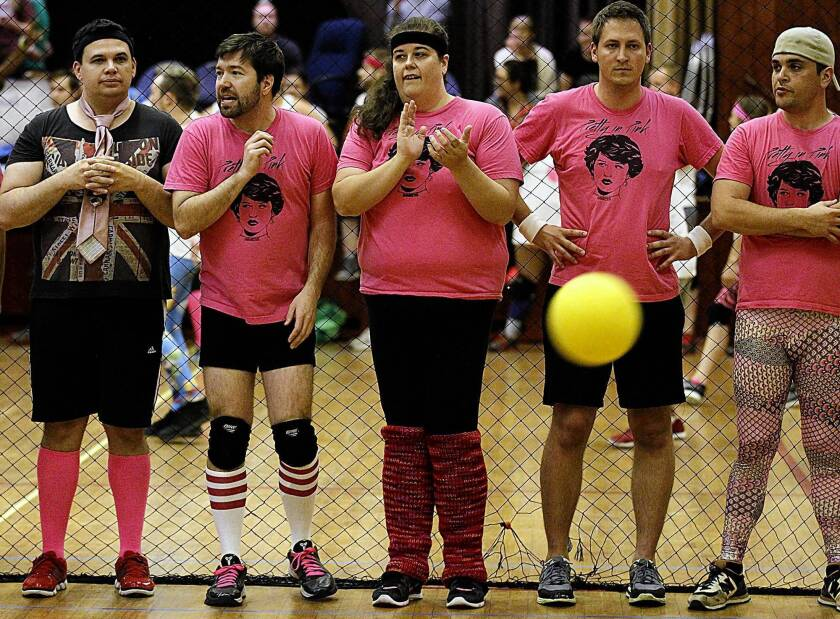 Jake Mason, second from left, an organizer of the WeHo Dodgeball League, watches from the sidelines as his team, Pretty in Pink, competes.