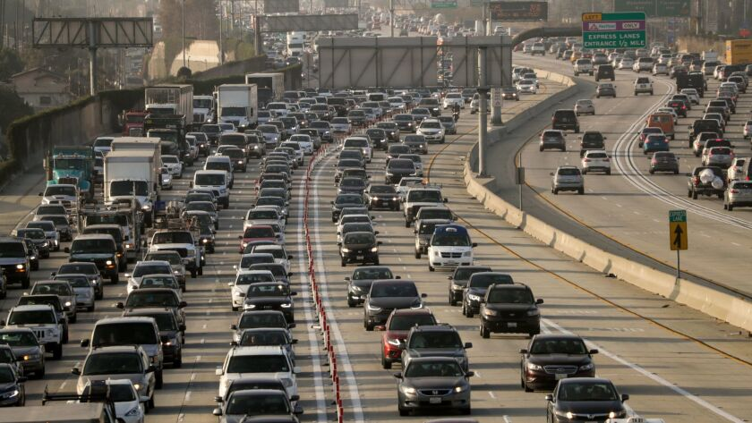Traffic clogs the 105 Freeway on a day last fall. Southern Californians have been on a car-buying binge, contributing to a decline in transit ridership, a UCLA study has found.