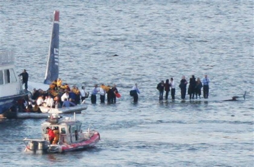 Passengers in an inflatable raft prepare to move away from an Airbus 320 US Airways aircraft that has gone down in the Hudson River in New York, Thursday Jan. 15, 2009. It was not immediately clear if there were injuries. (AP Photo/Bebeto Matthews)