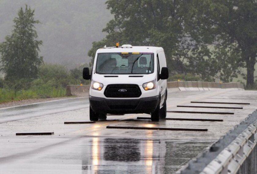 Ford says it is first automaker to develop robotic technology that drives vehicles during a series of durability tests.
