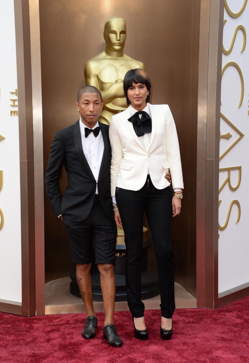 Pharrell Williams, wearing a Lanvin shorts tuxedo, and Helen Lasichanh.