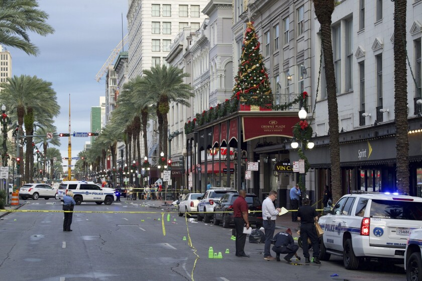 FILE - In this Dec. 1, 2019 file photo New Orleans police investigate the scene of a shooting on the edge of the city's famed French Quarter. Some type of personal feud is believed to have sparked the weekend shooting that left 10 people injured at the edge of New Orleans' historic French Quarter, police chief Shaun Ferguson said Monday, Dec. 2, 2019. (Max Becherer/The Times-Picayune/The New Orleans Advocate via AP)
