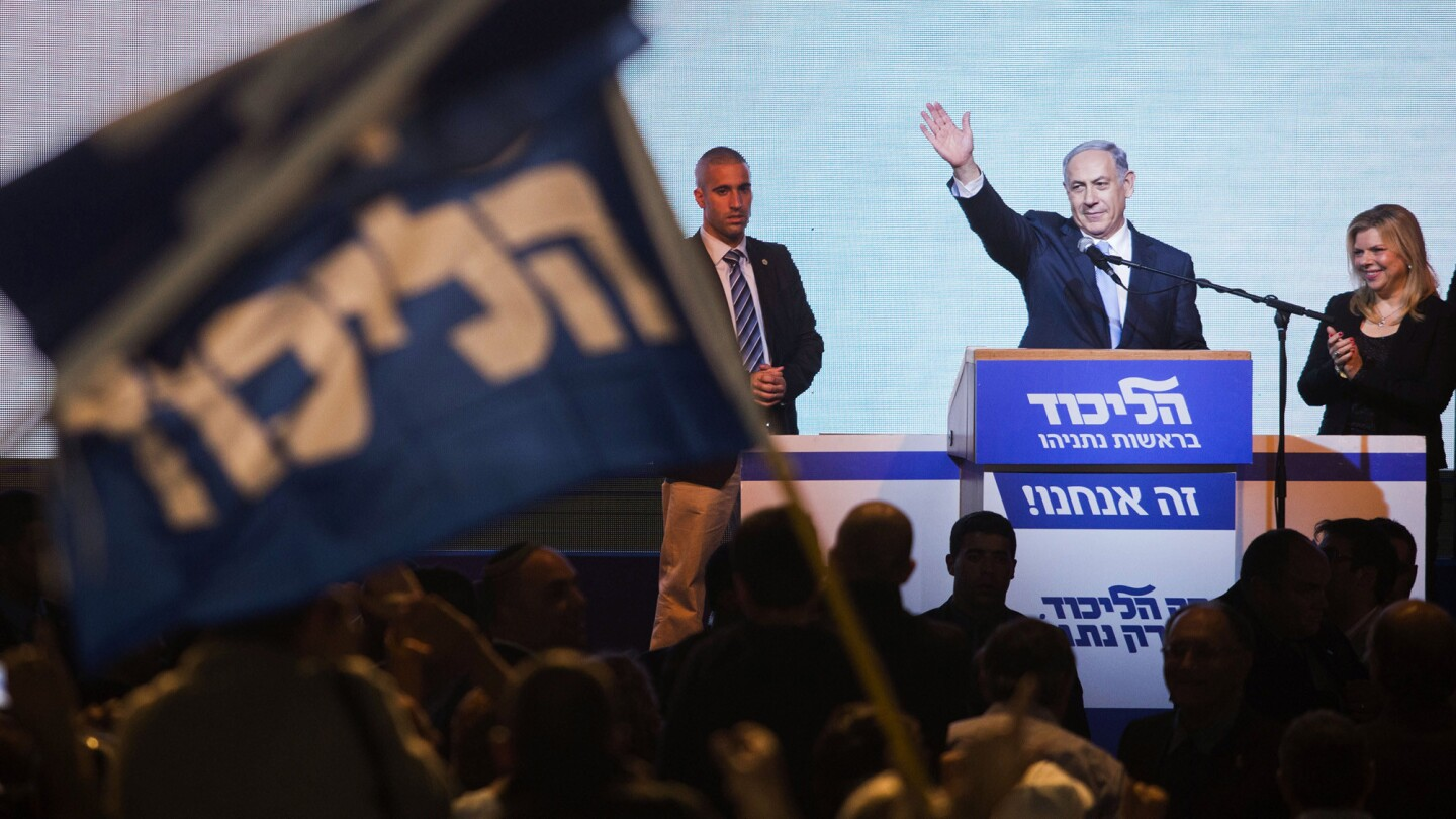 Israeli Prime Minister Benjamin Netanyahu greets supporters at the party's election headquarters In Tel Aviv on March 18, 2015.