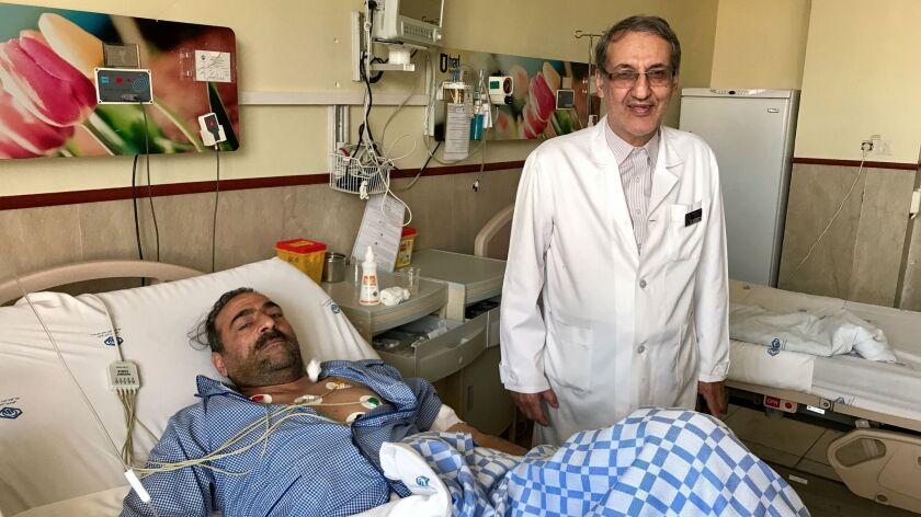Kidney transplant specialist Nasser Simforoosh with a patient at Shaheed Labbafinejad Medical Center