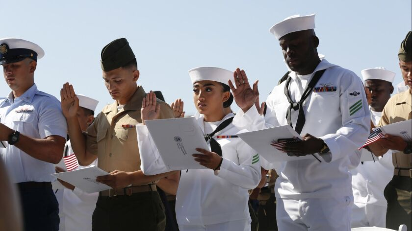 49 military personnel and family members take citizenship