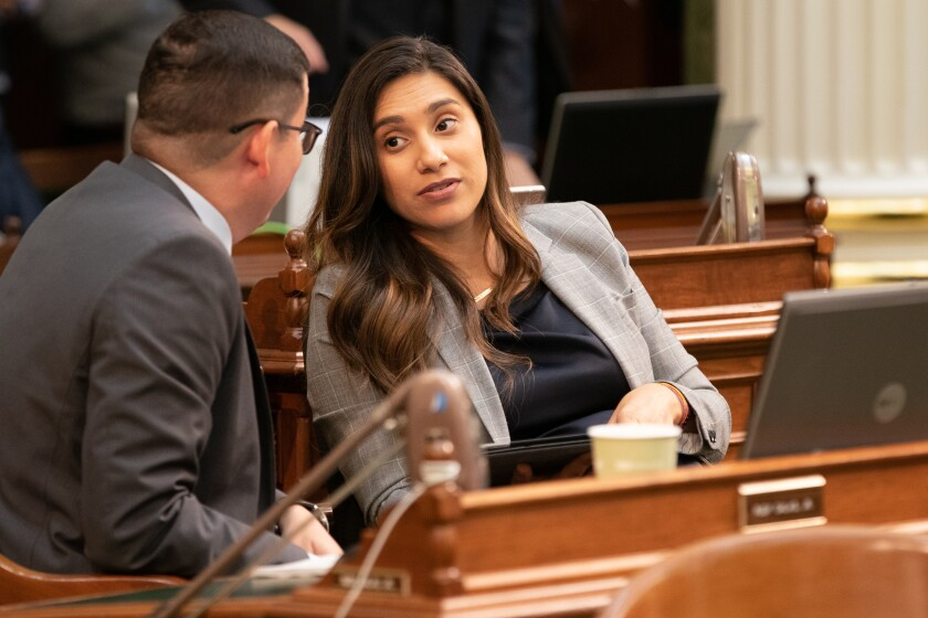 Assemblywoman Sabrina Cervantes (D-Riverside) talks with Assemblyman Rudy Salas (D-Bakersfield) during floor session at the state Capitol in August.