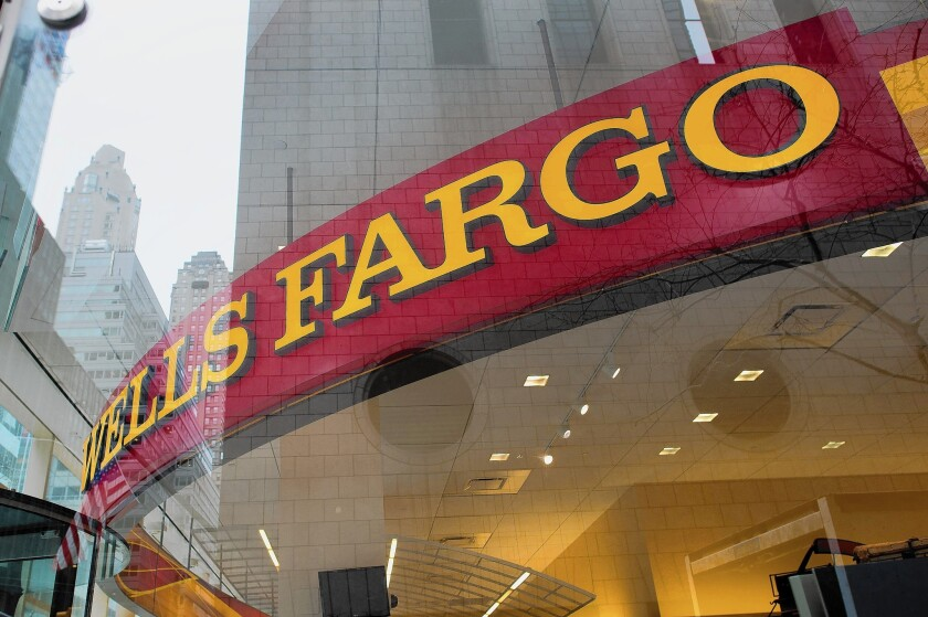 Wells Fargo's focus on Main Street business and its No. 1 position in mortgage lending were displayed as it kicked off the bank earnings season with a 3.8% increase. Above, a branch in New York.