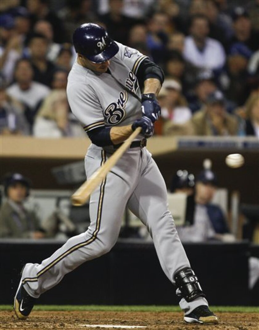 Milwaukee Brewers' Ryan Braun connects for his third consecutive home run against the San Diego Padres during the seventh inning of a baseball game Monday, April 30, 2012 in San Diego. (AP Photo/Lenny Ignelzi)