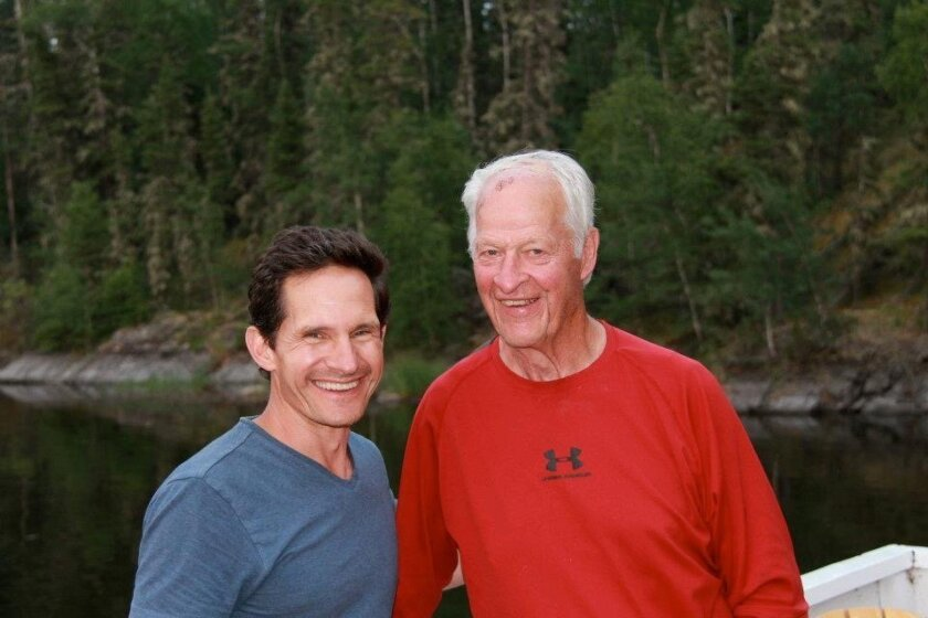 Dr. Murray Howe and his hockey great father, Gordie Howe, on a fishing trip in Saskatchewan in 2013.