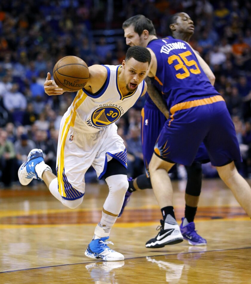 Golden State Warriors' Stephen Curry (30) is fouled by Phoenix Suns' Mirza Teletovic during the first half of an NBA basketball game Wednesday, Feb. 10, 2016, in Phoenix. (AP Photo/Matt York)