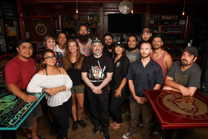 Border X Brewing founder David Favela, center, with his team at the Barrio Logan tasting room, was named a semifinalist Wednesday for a 2020 James Beard Award, the culinary industry's most prestigious awards program. He launched the Mexican-style craft brewery with his nephews five years ago.