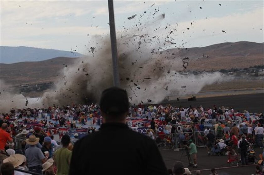 File - This Sept. 16, 2011 file photo shows a P-51 Mustang airplane crashing into the edge of the grandstands at Reno-Stead Airport during the Reno Air show in Stead, Nev. The World War II-era fighter plane flown by a veteran Hollywood stunt pilot Jimmy Leeward plunged into the apron of the grandstand, killing Leeward and 10 people on the ground and seriously injuring scores more. Race organizers are embracing the 50th anniversary of the National Air Racing Championships as they try to put the t