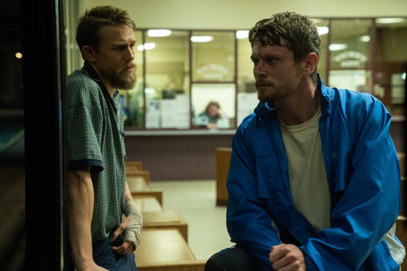 "Charlie Hunnam and Jack O'Connell in the movie ""Jungleland."""