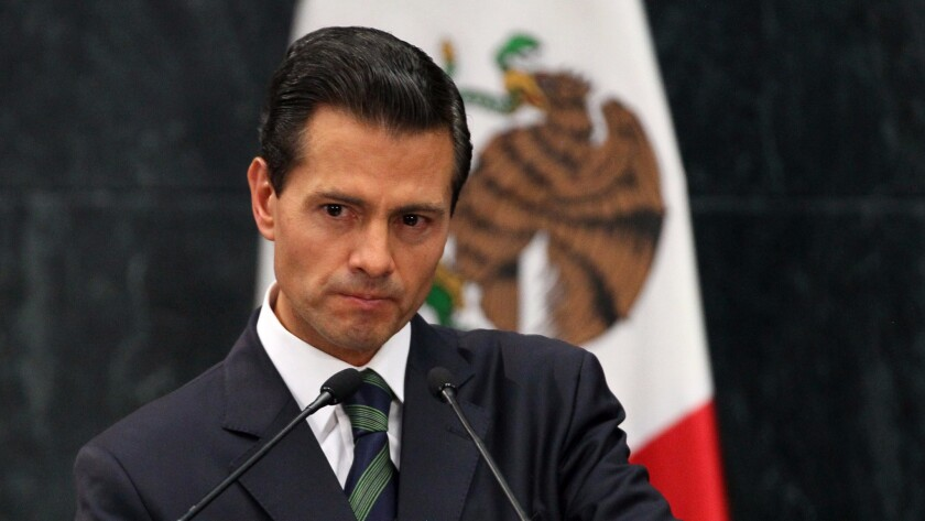 Mexican President Enrique Peña Nieto takes a question from the press during his joint appearance with Donald Trump after their meeting this week in Mexico City.
