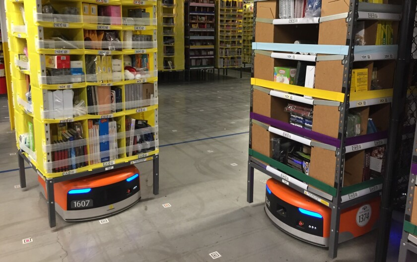 Amazon's orange Kiva robots lift stacks of merchandise and move them to employee stations. A new generation of warehouse robots from Locus Robotics will be able to travel long distances and scale high shelves that are out of reach of humans.