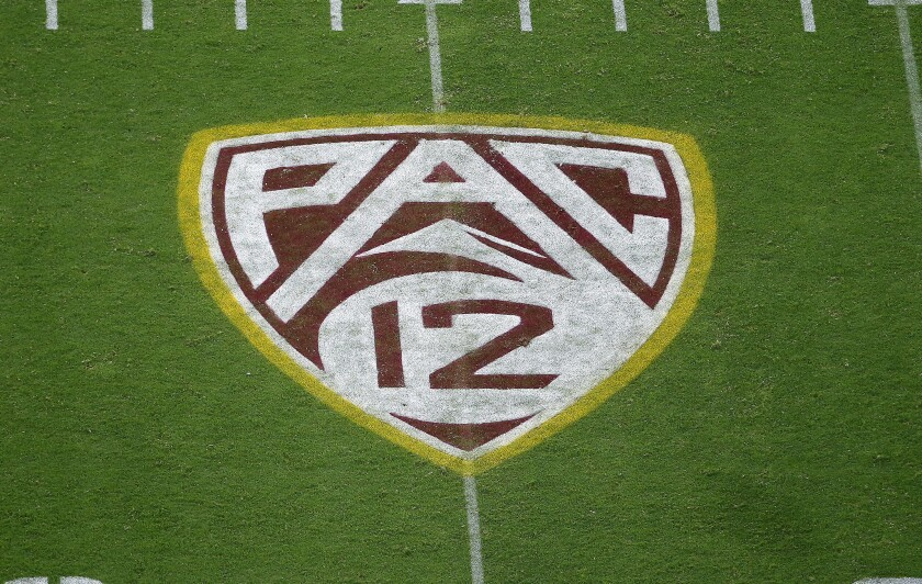 The Pac-12 logo on a football field.