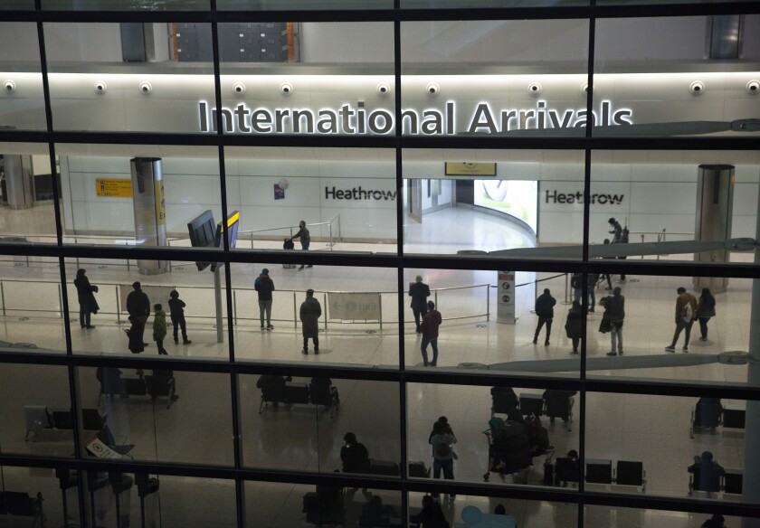 People in the international arrivals area at London's Heathrow Airport