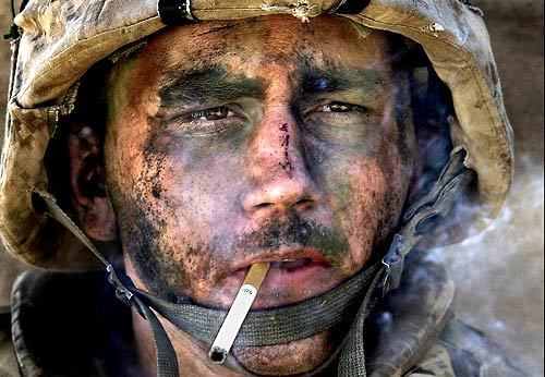 As a Marine Corps lance corporal, Blake Miller was with the 1st Marine Battalion, 8th Regiment, during the assault on the insurgent stronghold of Fallouja, Iraq, in November, 2004, when this picture was taken. Filthy and exhausted, he had just lighted a cigarette when an embedded photographer captured this image, which transformed Miller into an icon of the war in Iraq. He now suffers from post-traumatic stress disorder.