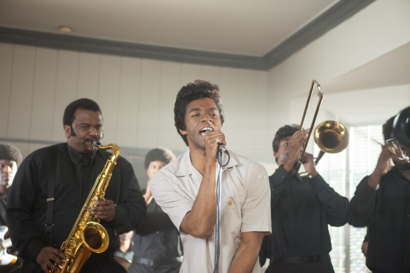 "Chadwick Boseman, center, and Craig Robinson in ""Get On Up."""