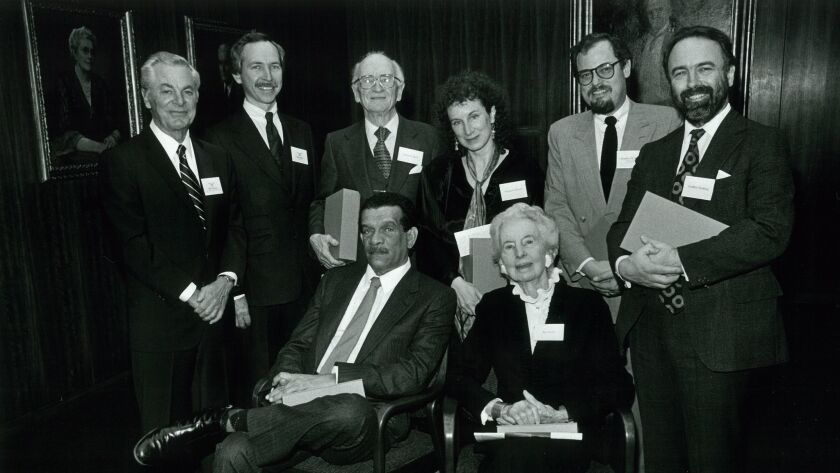Derek Walcott, seated left, after winning the 1986 L.A. Times Book Prize, with from left, Bill Thomas, Jack Miles (both from The Times), Maynard Mack, Margaret Atwood, Kay Boyle, Jonathan Segal and Geoffrey Hosking.